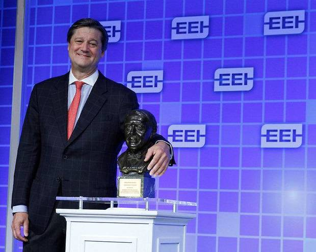 OGE Energy Corp. CEO Pete Delaney stands with the Edison Award given Monday to Oklahoma Gas and Electric Co. at the Edison Electric Institute's annual convention in San Francisco. It is the electric industry's most prestigious honor. <strong>Paul Sakuma - Paul Sakuma Photography</strong>