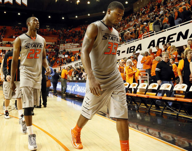 Oklahoma State's Marcus Smart (33) and Markel Brown (22) leave the court after a men's college basketball game between Oklahoma State University (OSU) and Gonzaga at Gallagher-Iba Arena in Stillwater, Okla., Monday, Dec. 31, 2012. Gonzaga won, 69-68. Photo by Nate Billings, The Oklahoman