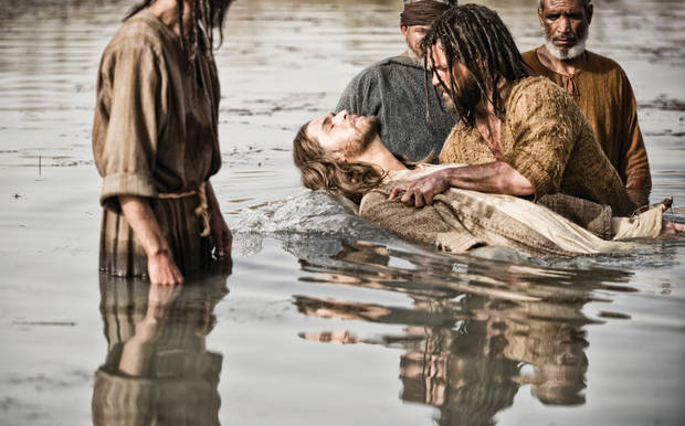 "In this scene from ""The Bible"" miniseries, Jesus, portrayed by Diogo Morcaldo, center, is baptized by John the Baptist, portrayed by  Daniel Percival.  <strong>Joe Alblas - AP</strong>"