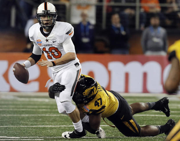 Missouri defensive lineman Kony Ealy (47) sacks Oklahoma State quarterback Clint Chelf (10) during the first half of the Cotton Bowl NCAA college football game on Friday, Jan. 3, 2014, in Arlington, Texas. (AP Photo/Brandon Wade)