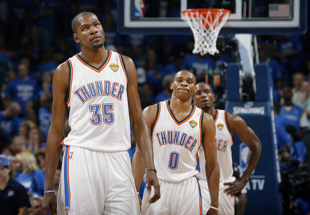Oklahoma City's Kevin Durant (35), Russell Westbrook (0) and Serge Ibaka (9) react during Game 2 of the NBA Finals between the Oklahoma City Thunder and the Miami Heat at Chesapeake Energy Arena in Oklahoma City, Thursday, June 14, 2012. Photo by Sarah Phipps, The Oklahoman