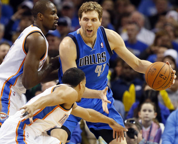 Oklahoma City's Serge Ibaka (9), top left, and Andre Roberson (21) defend Dallas's Dirk Nowitzki (41) during an NBA basketball game between the Oklahoma City Thunder and the Dallas Mavericks at Chesapeake Energy Arena in Oklahoma City, Sunday, March 16, 2014. Photo by Nate Billings, The Oklahoman