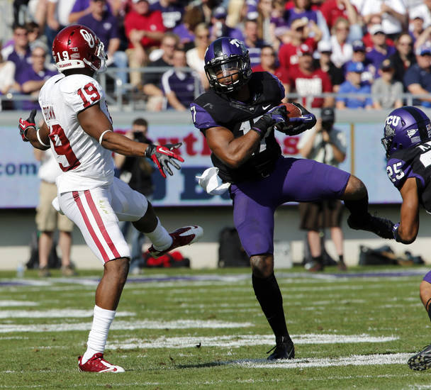 TCU&#039;s Sam Carter (17) intercepts a Landry Jones pass intended for Justin Brown (19) during the college football game between the University of Oklahoma Sooners (OU) and the Texas Christian University Horned Frogs (TCU) at Amon G. Carter Stadium in Fort Worth, Texas, on Saturday, Dec. 1, 2012. Photo by Steve Sisney, The Oklahoman