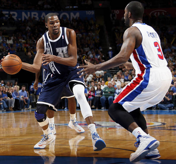 Oklahoma City's Kevin Durant (35) passes around Detroit's Rodney Stuckey (3) during an NBA basketball game between the Detroit Pistons and the Oklahoma City Thunder at the Chesapeake Energy Arena in Oklahoma City, Friday, Nov. 9, 2012. Oklahoma City won, 105-94. Photo by Nate Billings, The Oklahoman