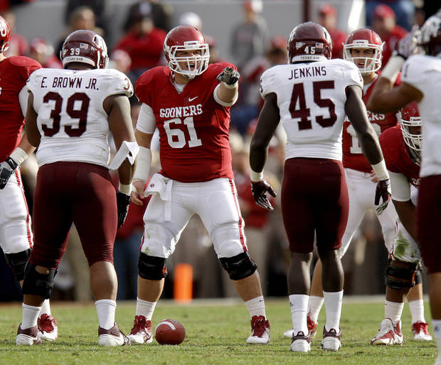Oklahoma&#039;s Ben Habern (61) points before the snap during the college football game between the Texas A&amp;M Aggies and the University of Oklahoma Sooners (OU) at Gaylord Family-Oklahoma Memorial Stadium on Saturday, Nov. 5, 2011, in Norman, Okla. Photo by Bryan Terry, The Oklahoman ORG XMIT: KOD