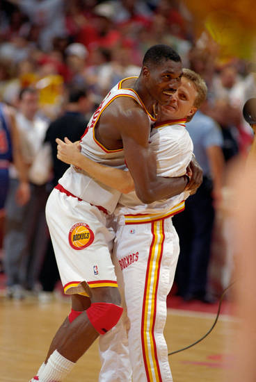 Scott Brooks, right, hugs Houston Rockets center Hakeem Olajuwon. Brooks is now the Oklahoma City Thunder coach. Photo provided by the Houston Chronicle.