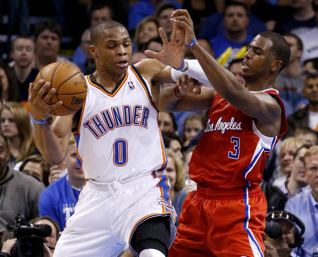 Oklahoma City&#039;s Russell Westbrook (0) tries to get past the Clippers Chris Paul (3) during an NBA basketball game between the Oklahoma City Thunder and the Los Angeles Clippers at Chesapeake Energy Arena in Oklahoma City, Wednesday, Nov. 21, 2012. Photo by Bryan Terry, The Oklahoman