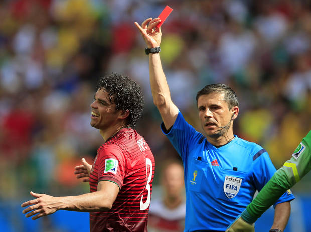Portugal's Pepe reacts after being shown a red card by referee Milorad Mazic during the group G World Cup soccer match between Germany and Portugal at the Arena Fonte Nova in Salvador, Brazil, Monday. (AP Photo/Bernat Armangue)
