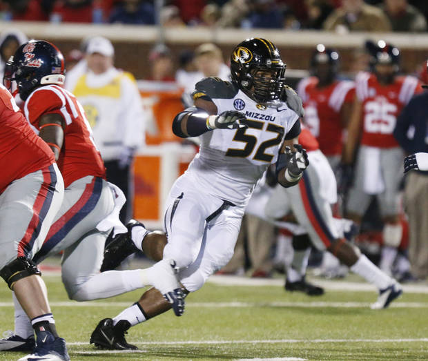 Missouri defensive lineman Michael Sam is one of the most dangerous pass rushers in the country. (AP Photo/Rogelio V. Solis)