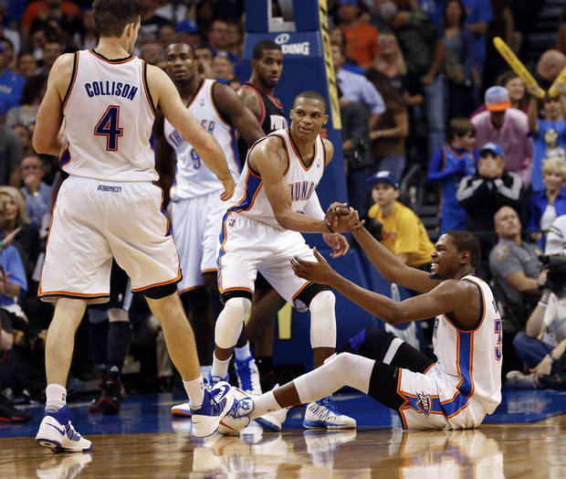 Oklahoma City Thunder's Nick Collison (4) and Russell Westbrook (0) help Kevin Durant (35) up after he is fouled on a shot as the Oklahoma City Thunder defeat the Portland Trail Blazers 106-92 in NBA basketball at the Chesapeake Energy Arena in Oklahoma City, on Friday, Nov. 2, 2012.  Photo by Steve Sisney, The Oklahoman