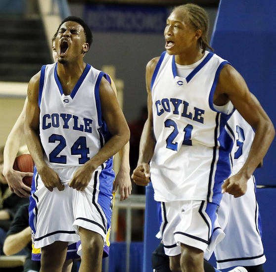 Coyle's Jakobi Brown (24) and Tony Aska (21) celebrate a play during a Class B Boys semifinal game of the state high school basketball tournament between Coyle and Red Oak at Jim Norick Arena, The Big House, on State Fair Park in Oklahoma City, Friday, March 1, 2013. Coyle won, 69-62. Photo by Nate Billings, The Oklahoman