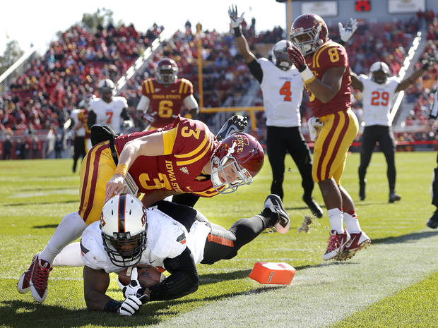 Oklahoma State 's Tyler Johnson (40) dives in for a touchdown after a fumble recovery as Grant Rohach (3) tackles him during the college football game between the Oklahoma State University (OSU) and Iowa State University (ISU) at Jack Trice Stadium in Ames, Iowa., Oct. 26, 2013. Photo by Sarah Phipps, The Oklahoman