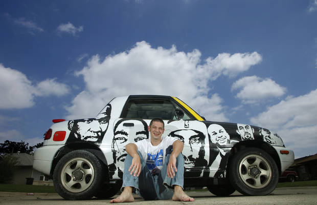 Drew Hooper sits Wednesday near his car, on which he has painted the faces of Thunder players. Faces from left: Kendrick Perkins, Kevin Durant, James Harden, Derek Fisher, Nick Collison and Cole Aldrich. Photo by Doug Hoke, The Oklahoman