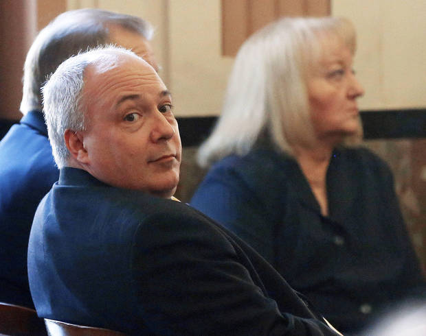 Former state Rep. Randy Terrill, front, of Moore, and former state Sen. Debbe Leftwich, right, of Oklahoma City, wait Wednesday in an Oklahoma County courtroom. A trial date for the two ex-lawmakers was set for October. AP PHOTO