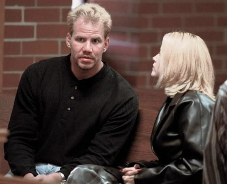 Photo - File photo -- Former World Boxing Organization Heavyweight Champion Tommy Morrison and his wife, Dawn, talk before a hearing in Washington County Circuit Court in Fayetteville, Ark., in this Oct. 18, 1999, file photo. Morrison was been arrested again on charges of public intoxication and illegally possessing a weapon Friday, Nov. 26, 1999, after running from an automobile accident near Huntsville, Ark., on Thanksgiving Day. (AP Photo/April L. Brown, File)