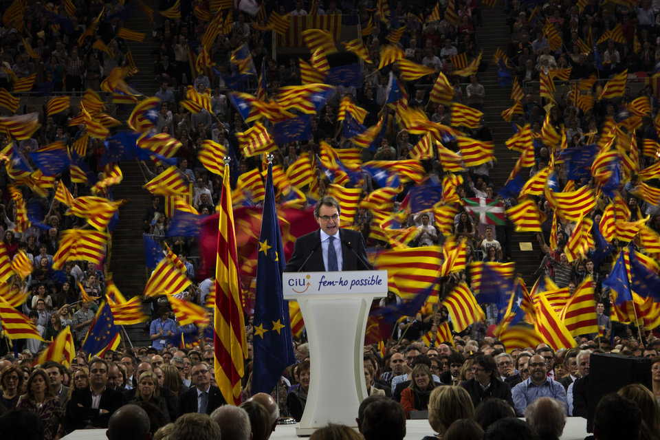 The leader of center-right Catalan Nationalist Coalition (CiU), Artur Mas, talks to his supporters during the last day of campaigning in a meeting in Barcelona, Spain, Friday, Nov. 23, 2012. Catalonia holds elections on Sunday that will be seen as a test of the regional government's plans to hold a referendum on independence, and one of the key issues emerging is the theoretical place of a free Catalonia in Europe. (AP Photo/Emilio Morenatti)