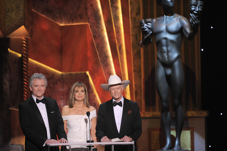Photo -   FILE - In this Sunday, Jan. 29, 2012 file photo, Patrick Duffy, left, Linda Gray, center, and Larry Hagman present the award for outstanding performance by an ensemble in a drama series at the 18th Annual Screen Actors Guild Awards in Los Angeles. Actor Larry Hagman, who for more than a decade played villainous patriarch JR Ewing in the TV soap Dallas, has died at the age of 81, his family said Saturday Nov. 24, 2012. (AP Photo/Mark J. Terrill, File)
