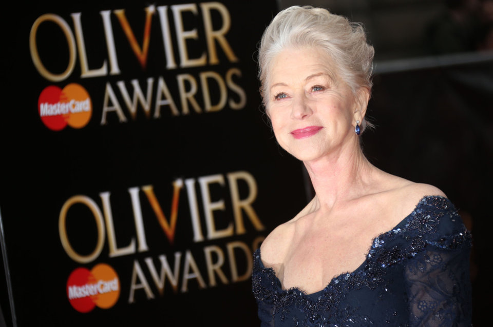 Photo - Helen Mirren poses on arrival at the Olivier Awards 2013 at the Royal opera House in London on Sunday, April 28, 2013. (Photo by Joel Ryan/Invision/AP)