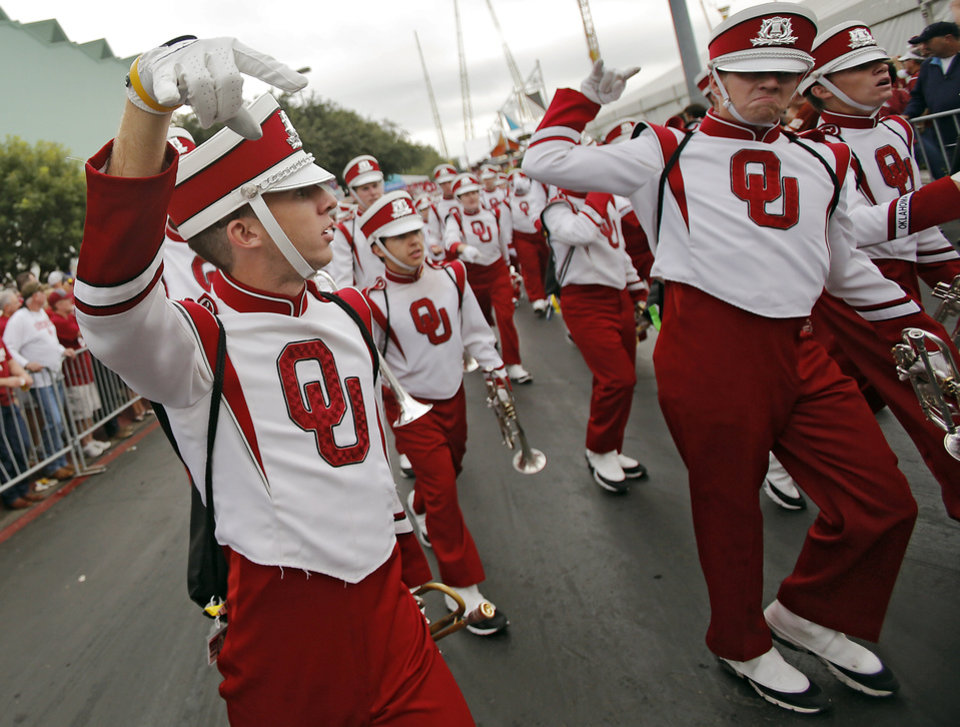 The Pride of Oklahoma makes their way to the stadium during the Red River Rivalry college football game between the University of Oklahoma Sooners (OU) and the University of Texas Longhorns (UT) at the Cotton Bowl Stadium in Dallas, Saturday, Oct. 12, 2013. Photo by Chris Landsberger, The Oklahoman