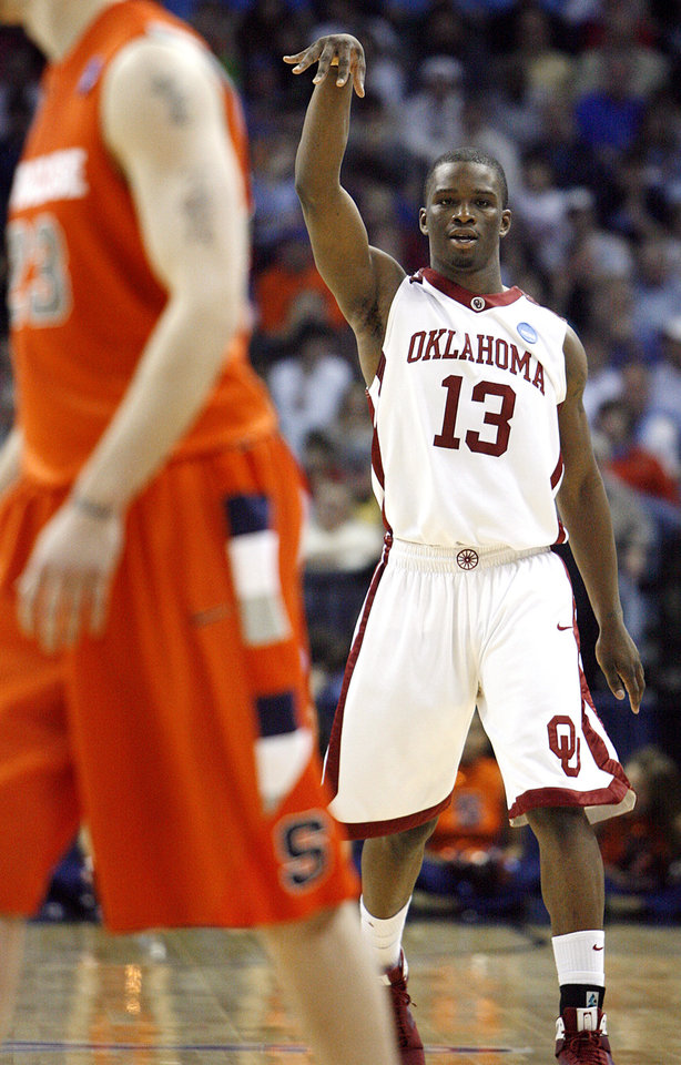 Oklahoma's Willie Warren reacts after hitting a three point shot against Syracuse during the second half of the NCAA Men's Basketball Regional at the FedEx Forum on Friday, March 27, 2009, in Memphis, Tenn.