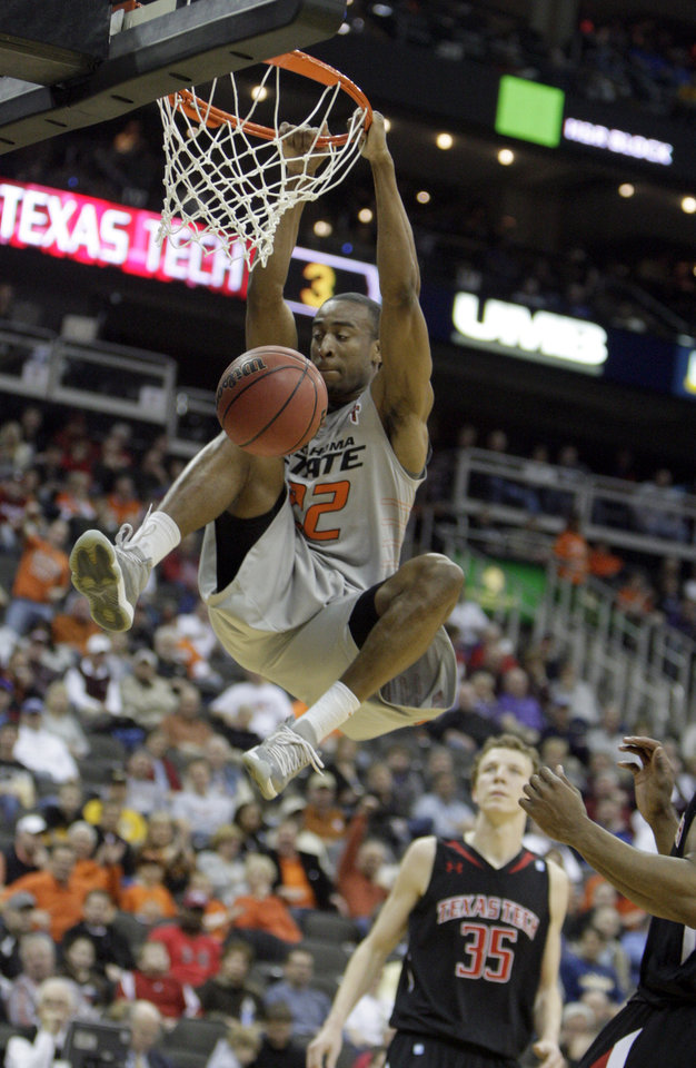 Photo - Oklahoma State's Markel Brown (22) dunks the ball during the Big 12 tournament men's basketball game between the Oklahoma State Cowboys and the Texas Tech Red Raiders at the Sprint Center, Wednesday, March, 6, 2012. Photo by Sarah Phipps, The Oklahoman