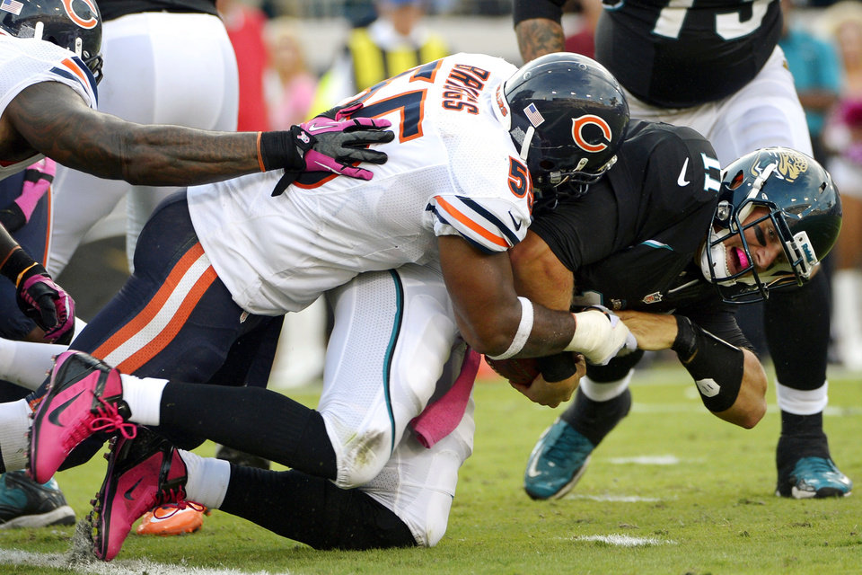 Jacksonville Jaguars quarterback Blaine Gabbert (11) is sacked by Chicago Bears outside linebacker Lance Briggs (55) during the second half of an NFL football game in Jacksonville, Fla., Sunday, Oct. 7, 2012. The Bears won 41-3. (AP Photo/Phelan M. Ebenhack)