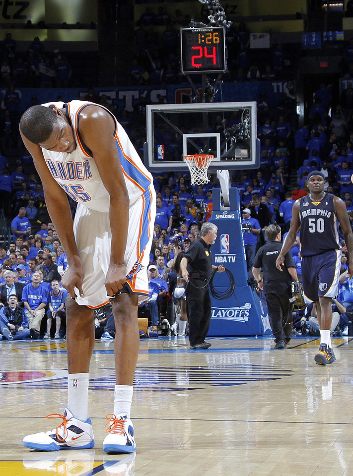 Photo - Kevin Durant (35) reacts late in the 114-101 loss to Memphis during game one of the Western Conference semifinals between the Memphis Grizzlies and the Oklahoma City Thunder in the NBA basketball playoffs at Oklahoma City Arena in Oklahoma City, Sunday, May 1, 2011. Photo by Chris Landsberger, The Oklahoman