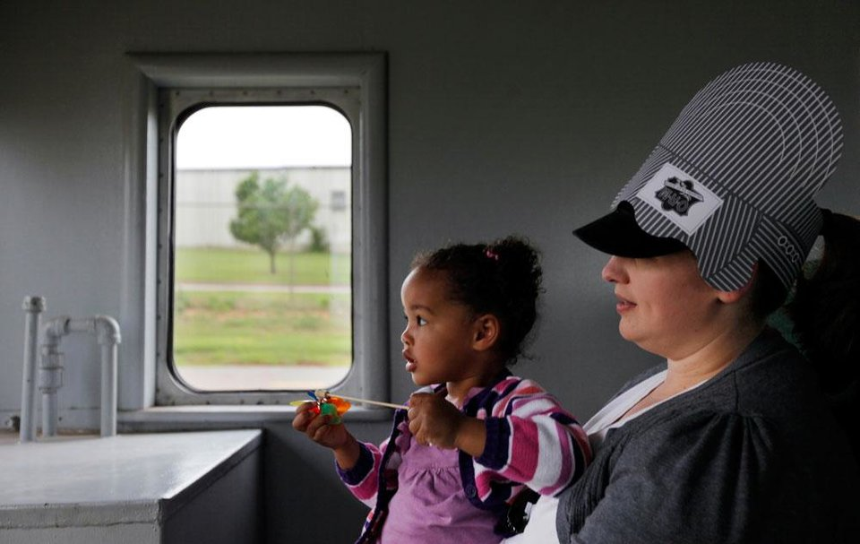 Photo -  Margaret Robinson holds her daughter, Marion Robinson, 2, as they take a train ride at the Oklahoma Railway Museum, 3400 NE Grand Blvd., in Oklahoma City, Saturday, April 7, 2012. The museum gives train rides the 1st and 3rd Saturday from April through August. Photo by Nate Billings, The Oklahoman