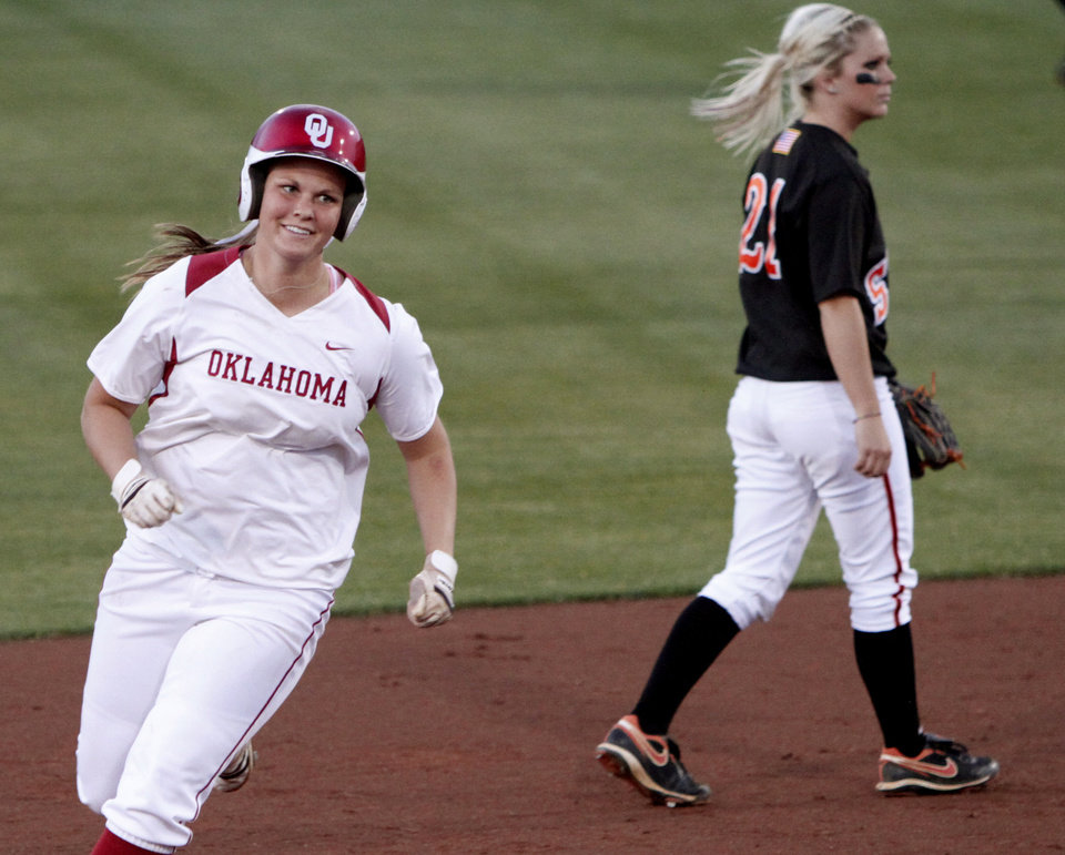 Photo - OSU: OU's Katie Norris rounds second base in front of OSU's Alysia Hamilton after a three-run home run in the third inning of the Bedlam college softball game between Oklahoma State University and the University of Oklahoma in Norman, Okla., Wednesday , April 28, 2010. Photo by Bryan Terry, The Oklahoman ORG XMIT: KOD