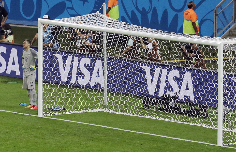 Photo - Brazil's goalkeeper Julio Cesar stands next to the post during the World Cup semifinal soccer match between Brazil and Germany at the Mineirao Stadium in Belo Horizonte, Brazil, Tuesday, July 8, 2014. Germany won 7-1.(AP Photo/Hassan Ammar)