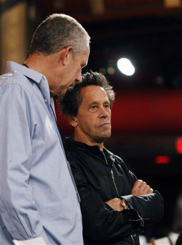 Assistant Producer Michael Rosenberg, left, and  Brian Grazer, producer of the 84th Academy Awards, talk during rehearsals for Sunday's show Saturday, Feb 25, 2012 in Los Angeles. (AP Photo/Chris Carlson)