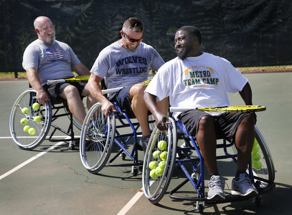 Photo -  From left Paul Horton, Brandon Taber and Tony Batchelor participate in  the veteran's wheelchair tennis clinic at Santa Fe Family Life Center. [PHOTO BY JIM BECKEL, THE OKLAHOMAN]