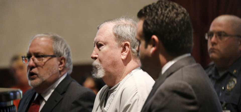Photo -  Former pharmacist Jerome Jay Ersland stands in court with his attorney, Doug Friesen, left, and a prosecutor at his sentencing Monday.     Jim Beckel -  THE OKLAHOMAN