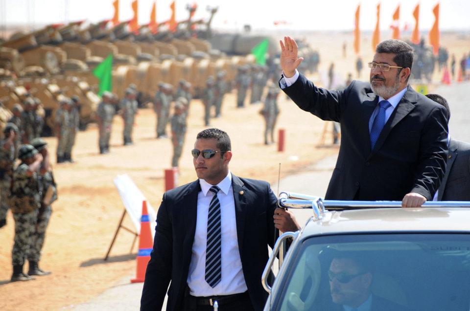 Photo -   In this image released by the Egyptian Presidency, Egyptian President Mohammed Morsi, waves toward soldiers at a military base in Ismailia, Egypt, Wednesday, Oct. 10, 2012. (AP Photo/Egyptian Presidency)