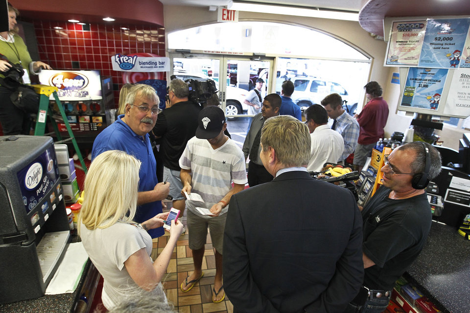 Photo - Patrons and members of the media gather at a 4 Sons Food Store where one of the winning tickets in the $579.9 million Powerball jackpot was purchased, Nov. 29, 2012, in Fountain Hills, Ariz.(AP Photo/Ross D. Franklin)