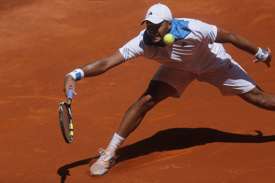 Photo - Jo-Wilfried Tsonga from France returns the ball during a Madrid Open tennis tournament match against Edouard Roger-Vasselin from France, in Madrid, Spain, Monday, May 5, 2014. (AP Photo/Andres Kudacki)