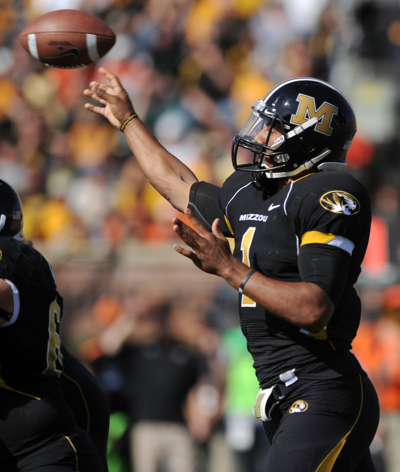 Photo - Missouri quarterback James Franklin throws during the first half of an NCAA college football game against Oklahoma State, Saturday, Oct. 22, 2011, in Columbia, Mo. (AP Photo/L.G. Patterson)