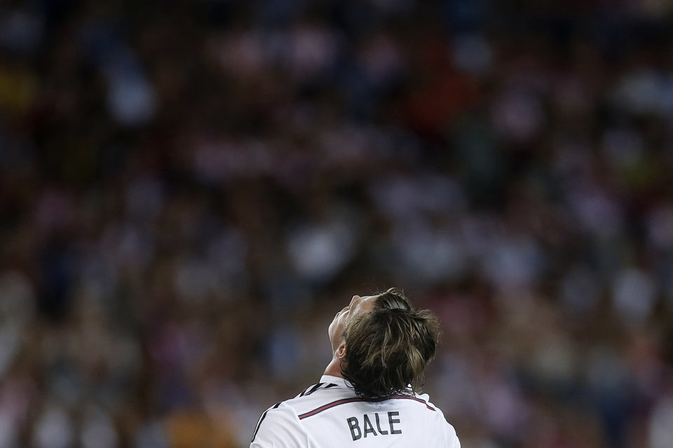 Photo - Real Madrid Gareth Bale, reacts during a Spanish Super Cup soccer match against Atletico Madrid at the Vicente Calderon stadium in Madrid, Spain, Friday, Aug. 22, 2014 . (AP Photo/Daniel Ochoa de Olza)