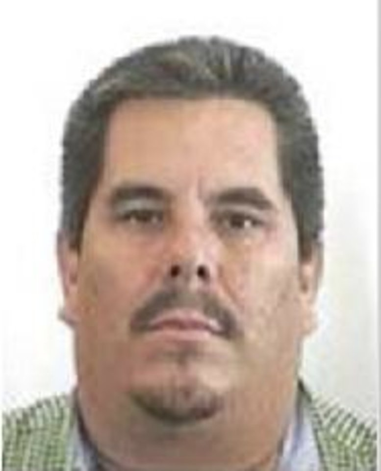 Photo -   This undated image taken from the Mexican Attorney General's rewards program website on June 21, 2011, shows the alleged leader of the La Familia cartel, Jose de Jesus Mendez Vargas, alias