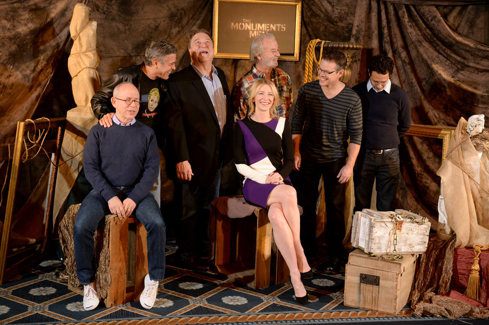 Photo - In this Thursday, Jan. 16, 2014 photo, from left, actor Bob Balaban, director, screenwriter and actor, George Clooney, actor John Goodman,  actor Bill Murray, actress Cate Blanchett, actor Matt Damon and screenwriter Grant Heslov pose during a photocall for