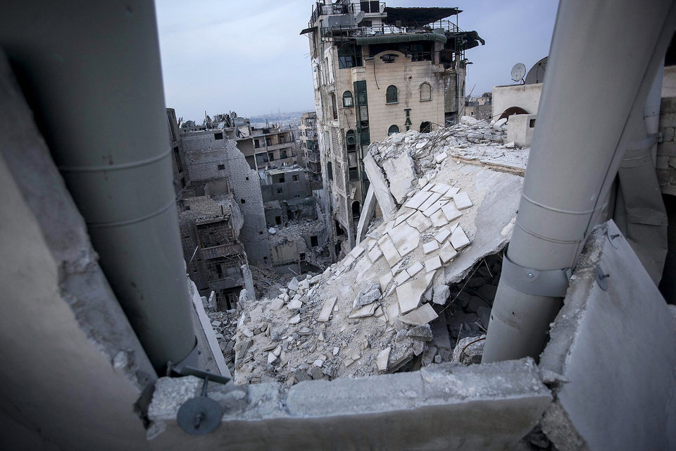 In this Thursday, Nov. 29, 2012 photo, destroyed buildings, including Dar Al-Shifa hospital, bottom, are seen after airstrikes targeted the area last week in Aleppo, Syria. (AP Photo/Narciso Contreras)