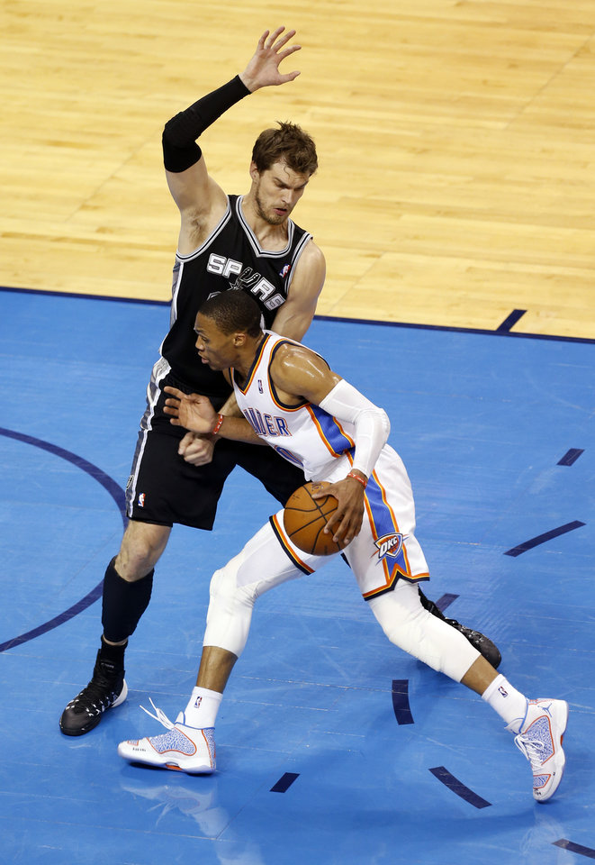 Photo - Oklahoma City's Russell Westbrook (0) tries to get by San Antonio's Tiago Splitter (22) during Game 6 of the Western Conference Finals in the NBA playoffs between the Oklahoma City Thunder and the San Antonio Spurs at Chesapeake Energy Arena in Oklahoma City, Saturday, May 31, 2014. Photo by Nate Billings, The Oklahoman