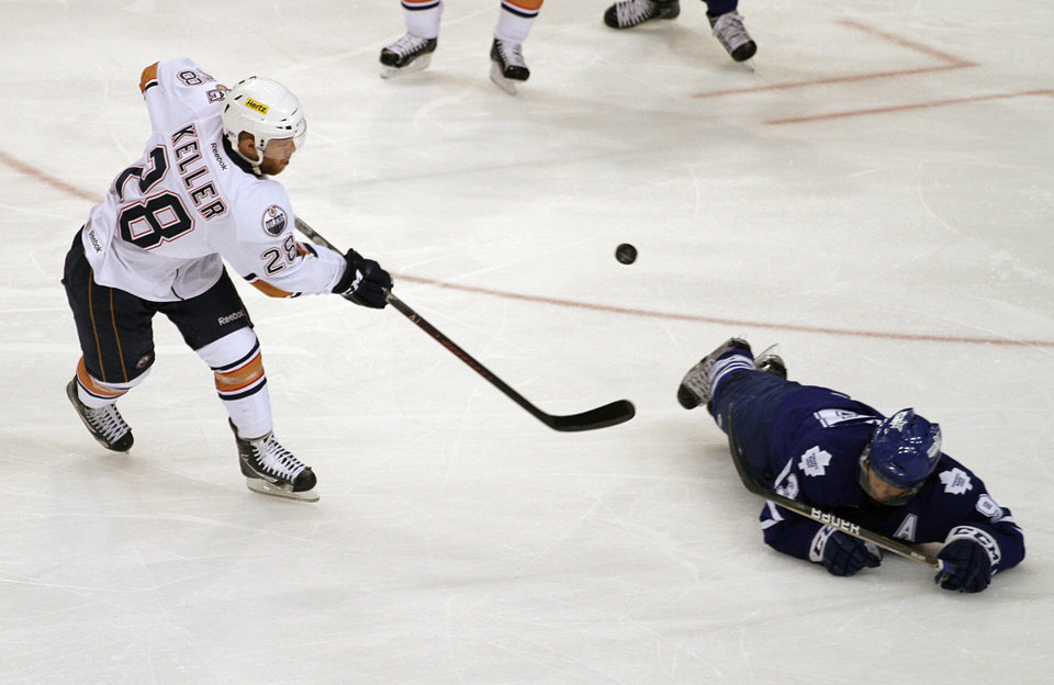 OKC's Ryan Keller, left, hits a puck past Toronto's Nazem Kadri during Game 2 of the Western Conference Finals at the Cox Convention Center on Friday. The Barons won, 5-1. Photo by Garett Fisbeck, For The Oklahoman