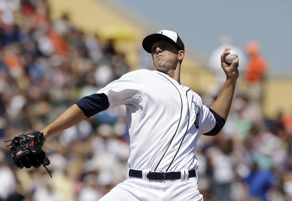 Photo - Detroit Tigers starting pitcher Drew Smyly throws during the first inning of a spring exhibition baseball game against the Toronto Blue Jays in Lakeland, Fla., Tuesday, March 18, 2014. (AP Photo/Carlos Osorio)