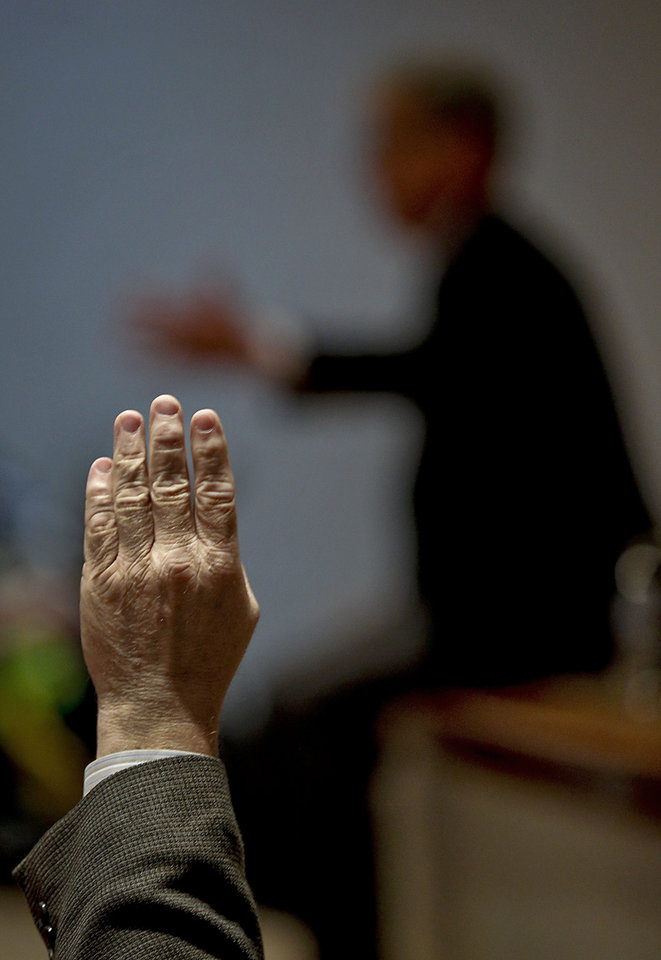 An attendee to U.S. Senator Tom Coburn town hall meeting raises a hand to speak at the Metro Tech Springlake campus on Wednesday in Oklahoma City. Photo by Chris Landsberger, The Oklahoman <strong>CHRIS LANDSBERGER</strong>