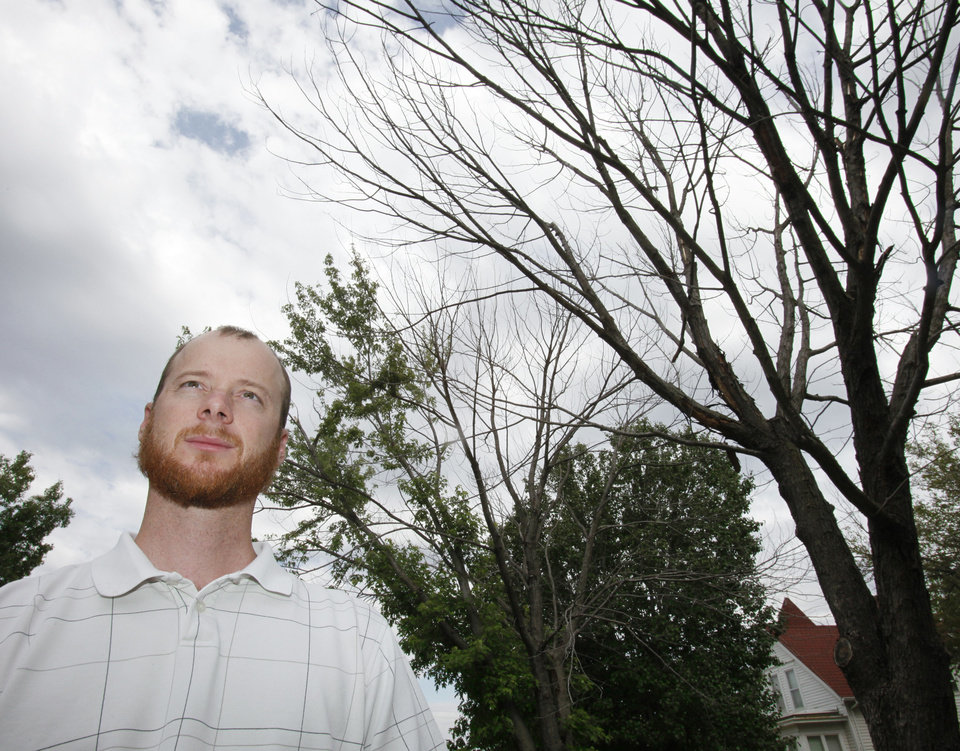 Ryan Ochsner, urban forestry coordinator in Edmond, with a Silver Maple that is 80 percent dead, Friday, June 1, 2012. Trees have been weakened by the drought in 2011. Photo By David McDaniel/The Oklahoman