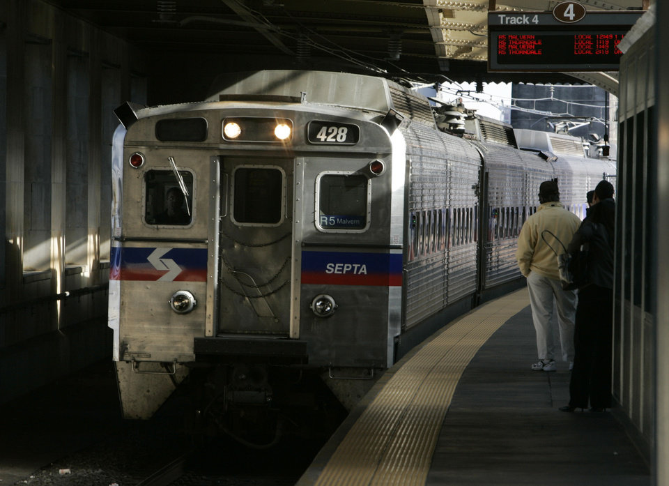 Photo - FILE - A SEPTA regional train, the R7, rolls into 30th Street station in Philadelphia in this Nov. 16, 2004 file photo. Four hundred workers at a Philadelphia-area regional rail system went on strike Saturday morning June 14, 2014, shutting down 13 train lines that carry commuters to the suburbs and Philadelphia International Airport. Subways, trolleys and buses operated by SEPTA will continue to run.  (AP Photo/Jacqueline Larma, File)