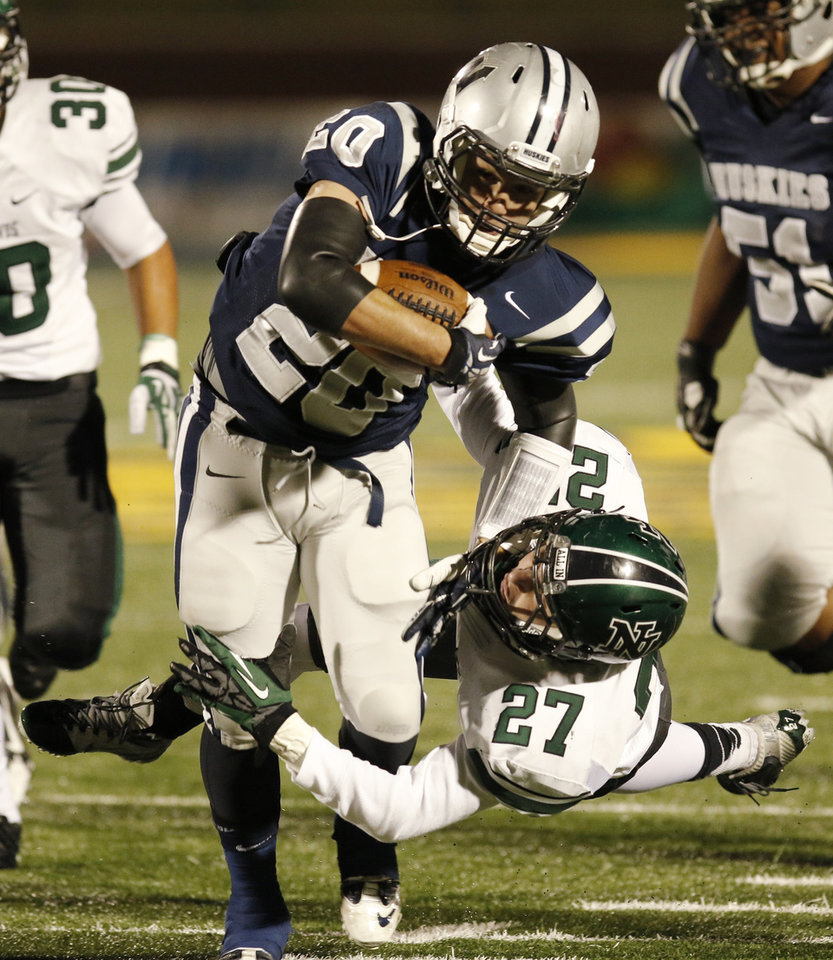 NN#27 Christopher Briley dives for EN#20 Zack Jenkins during the high school football game between Norman North and Edmond North in Edmond at Wantland Stadium Friday, Friday, October 18, 2013.  Photo by Doug Hoke, The Oklahoman