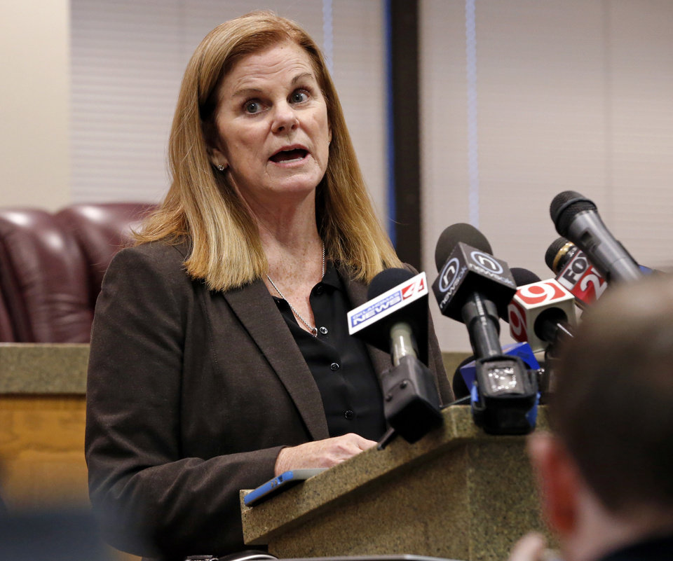 Photo - Cleveland County First Assistant District Attorney Susan Caswell details reasons why no charges will be brought against University Of Oklahoma (OU) running back Rodney Anderson during a press conference on Thursday, Dec. 14, 2017 in Norman, Okla.  Anderson was accused of rape just days after the Big 12 Championship by a woman he met weeks earlier in a bar.  Photo by Steve Sisney, The Oklahoman