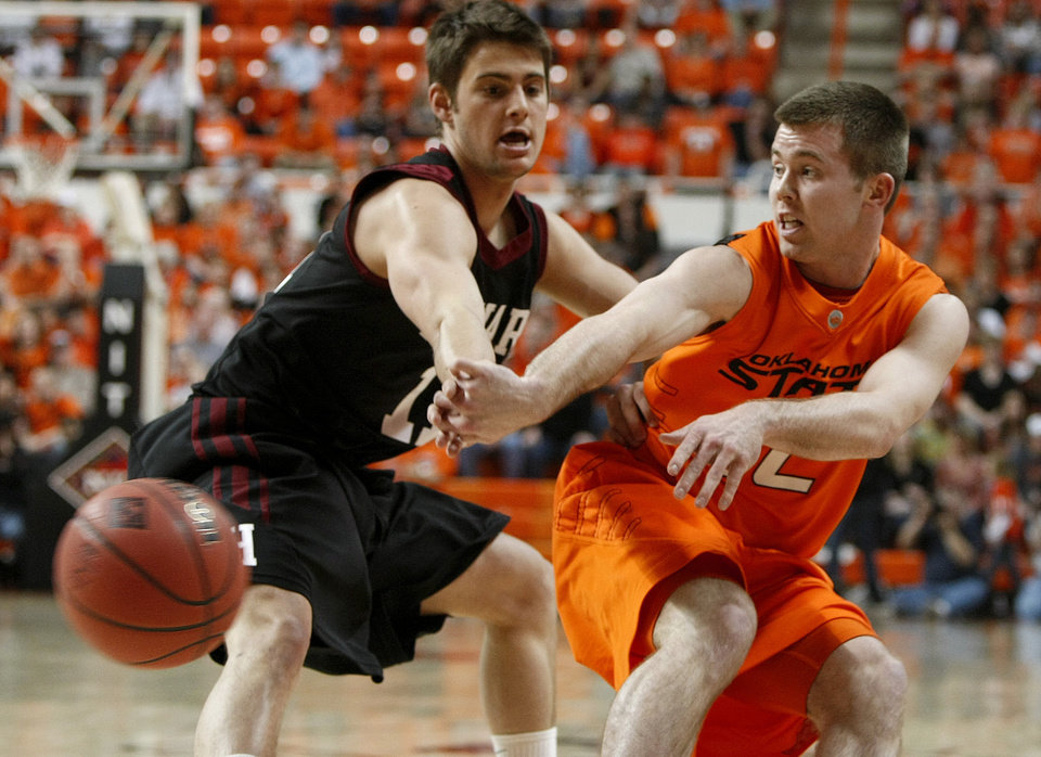Photo - Oklahoma State's Keiton Page (12) passes the ball past Harvard's Oliver McNally (11) during a first-round NIT college basketball game between Oklahoma State University (OSU) and Harvard at Gallagher-Iba Arena in Stillwater, Okla., Tuesday, March 15, 2011. Photo by Bryan Terry, The Oklahoman